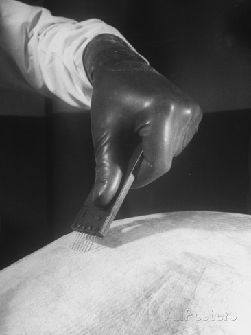 scientist-scraping-skin-of-calf-for-use-in-production-of-smallpox-vaccine.jpg